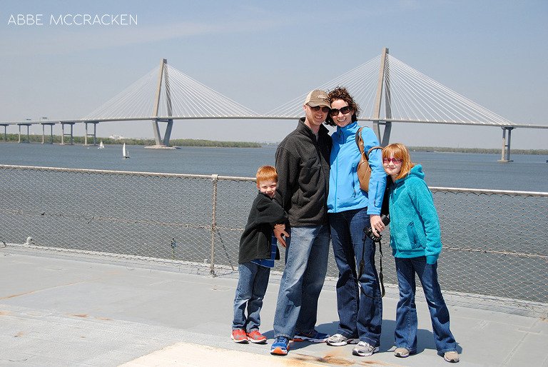 family on the USS Yorktown outside Charleston, Copper River Bridge in background