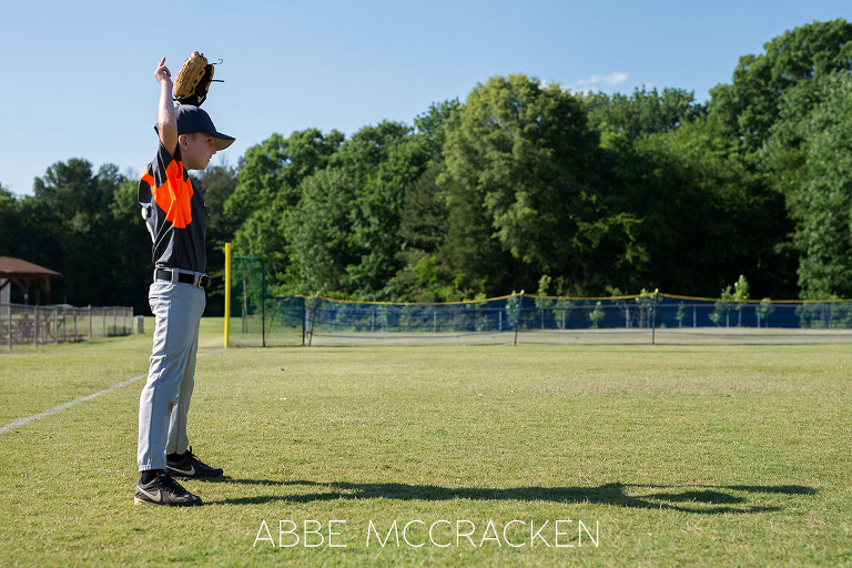 Youth Baseball Photography of a young boy in South Charlotte Recreation Association machine pitch league warming up