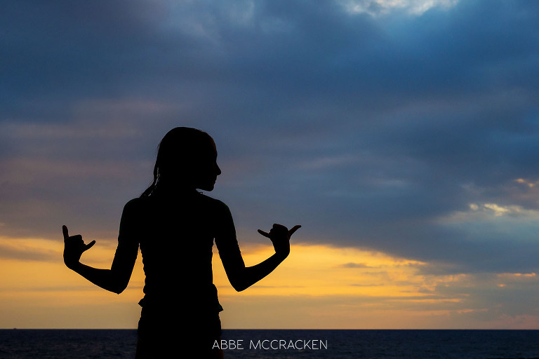 vacation photos - colorful silhouette of Charlotte photographer Abbe McCracken's daughter enjoying a Big Island, HI sunset