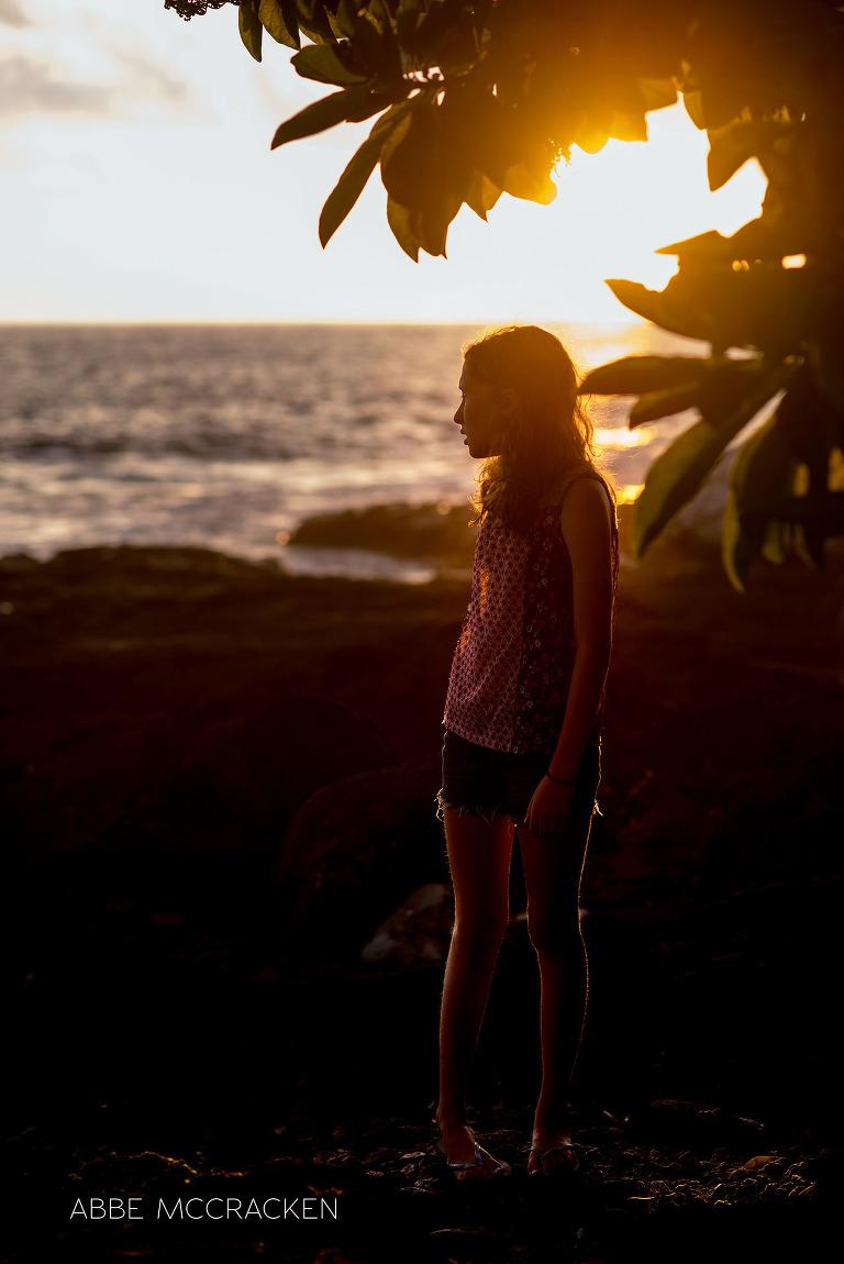 vacation photos with gorgeous rim light - Charlotte photographer Abbe McCracken's daughter enjoying a Hawaiian sunset