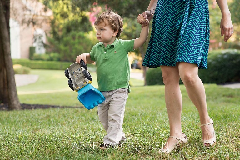 Summer family photo session - Mom and youngest son walking across their front yard