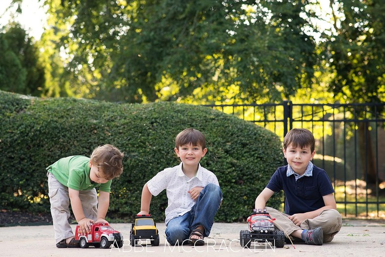 Summer family photography session at home - 3 boys in the driveway with trucks
