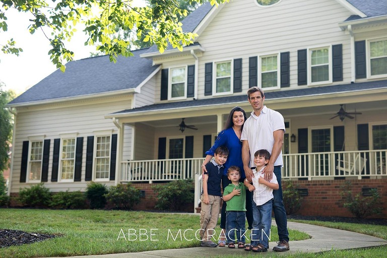 Family portrait in front of their Charlotte, NC home