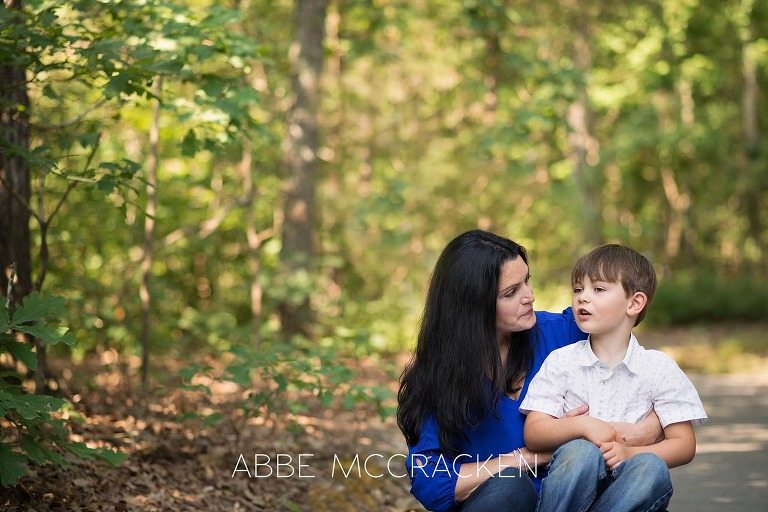 Mother and son talking during a summer family photography session at Squirrel Lake Park in Matthews, NC