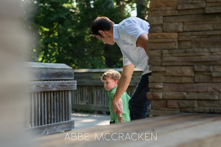 Portrait of parenthood - father chasing toddler - at Squirrel Lake Park in Matthews, NC