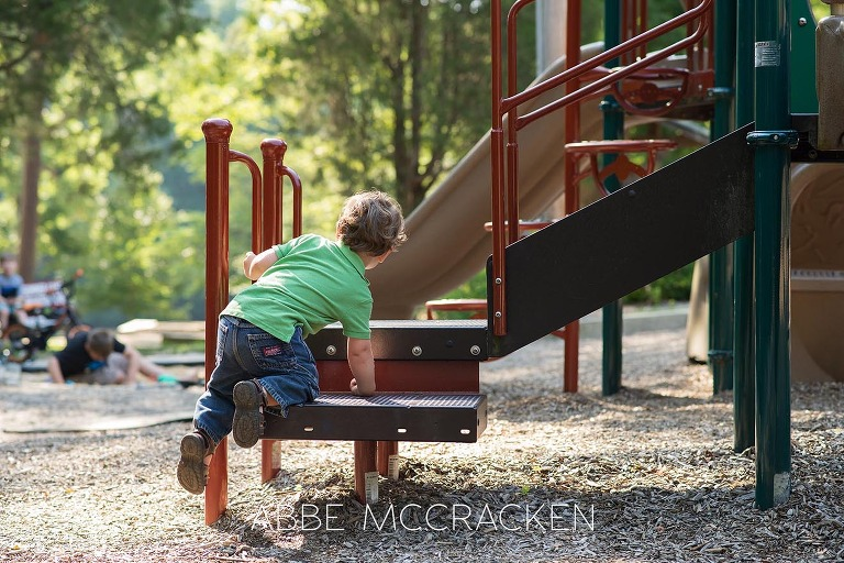 Candid image of a toddler playing at Squirrel Lake Park in Matthews, NC - July 2016
