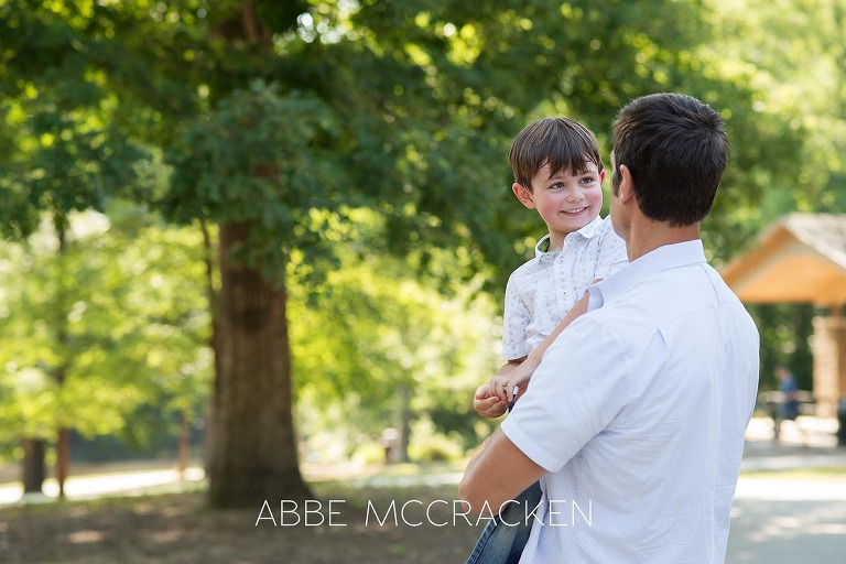 Lifestyle image of a father and son at Squirrel Lake Park in Matthews, NC - July 2016