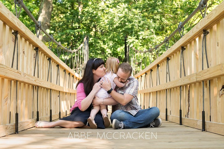 natural, relaxed, candid family pictures in Charlotte's Freedom Park with a two year old