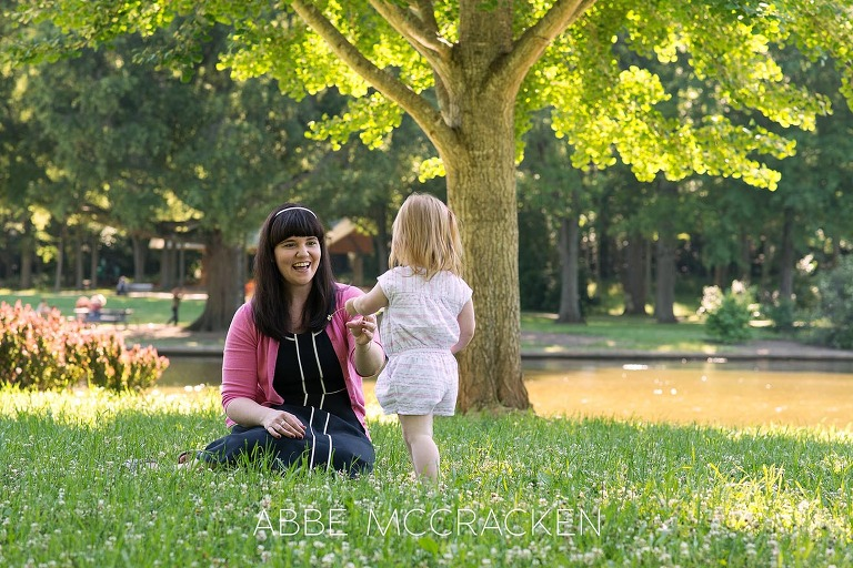 Candid mother-daughter image in Charlotte NC's Freedom Park - family portraits