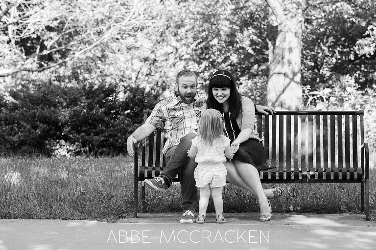 Black and white, candid portrait of a young family in Charlotte's Freedom Park