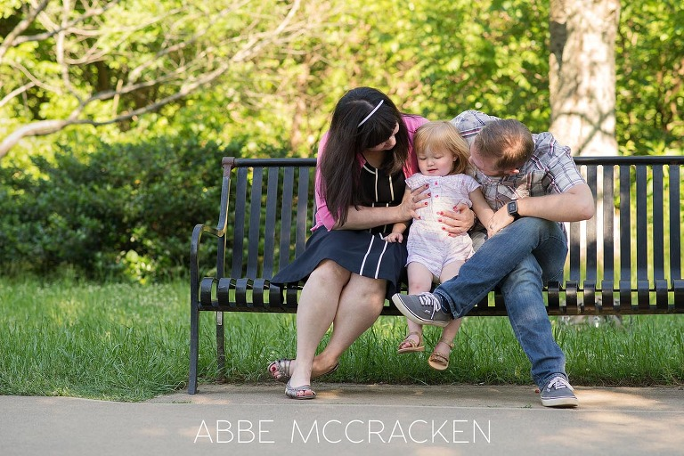 candid portrait of a young family in Charlotte's Freedom Park