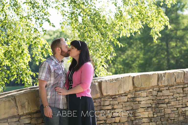 couple kissing photographed during spring family pictures in Charlotte's Freedom Park