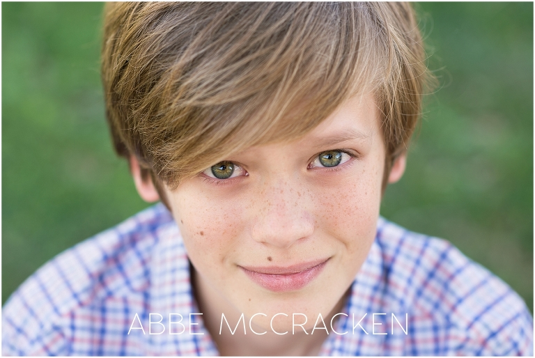 Young tween boy with green eyes and freckles