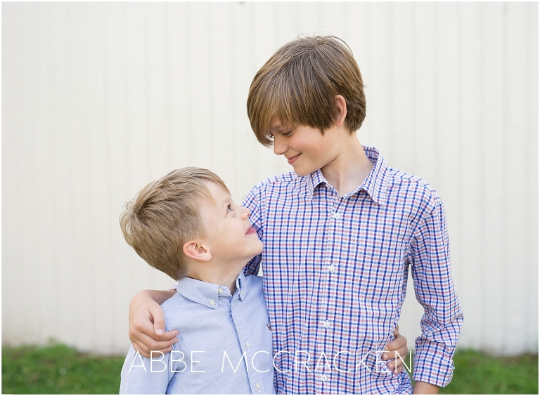 Candid portrait of brothers photographed during a family session in Charlotte's Freedom Park