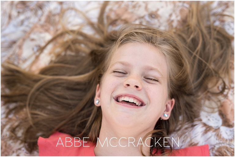 Image of a girl laughing, gorgeous smile full of joy