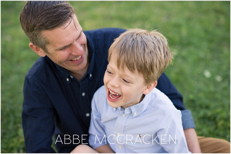 Joyful picture of father and son laughing