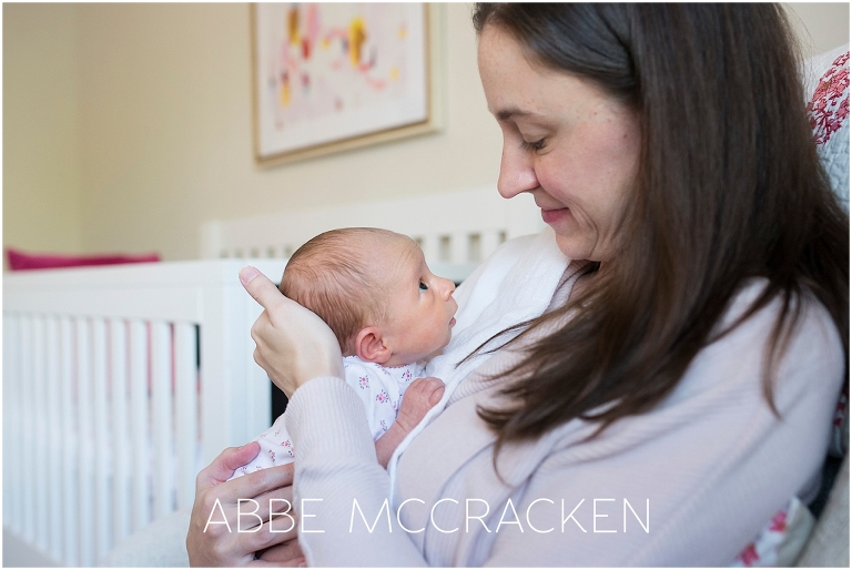 Newborn baby girl at home with mom   Newborn photography Charlotte NC
