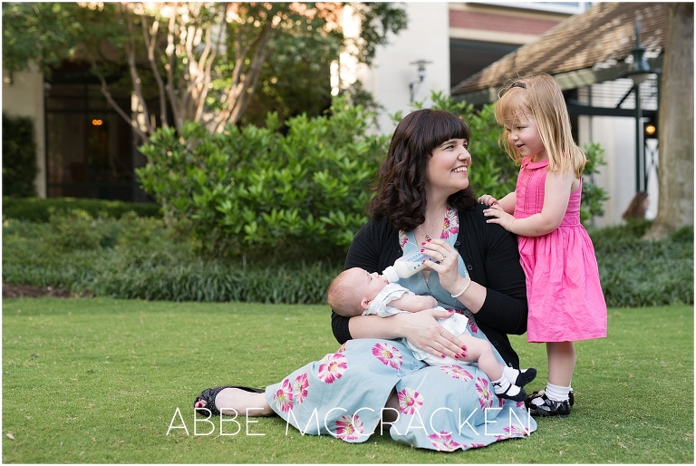 Candid, lifestyle family portraits in Uptown Charlotte - mother and two girls