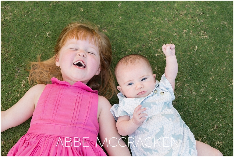 Candid, lifestyle family portraits in Uptown Charlotte - siblings