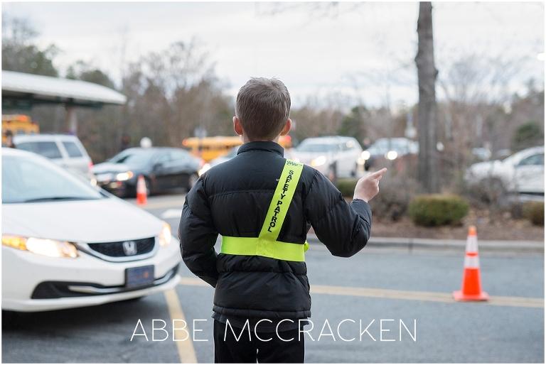 Young boy on Safety Patrol duty at school