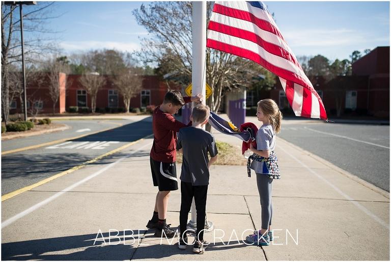 School children taking down flags