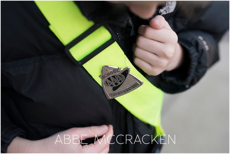 Child admiring his Safety Patrol badge