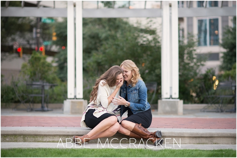 Image of mother and her high school senior laughing in Charlotte's Romare Bearden Park