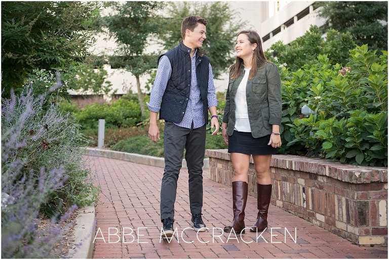 Candid sibling picture taken during an urban high school senior session in Uptown Charlotte