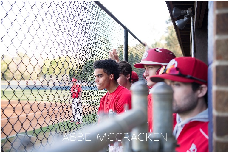 Dugout shot of Bryce Daniel and high school baseball teammates