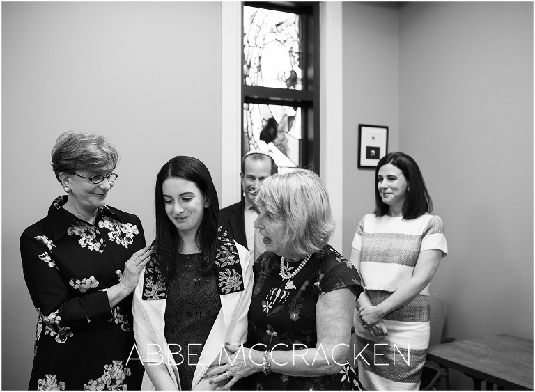 A candid moment of grandmothers, mother and daughter during a Bat Mitzvah at Temple Beth El in Charlotte, NC
