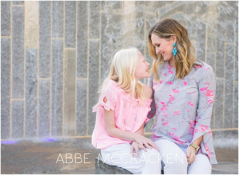 Tender moment between mother and daughter in Charlotte's Romare Bearden Park