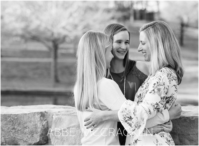 Black and white photo of a mother and two teenage daughters
