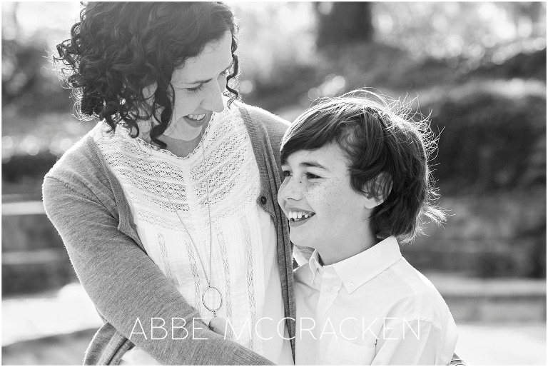Joyful backlit image of a mother and son, candid