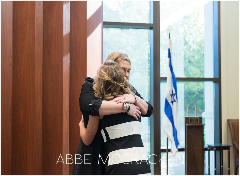 Mother and daughter embrace during Bat Mitzvah at Temple Beth El in Charlotte, NC