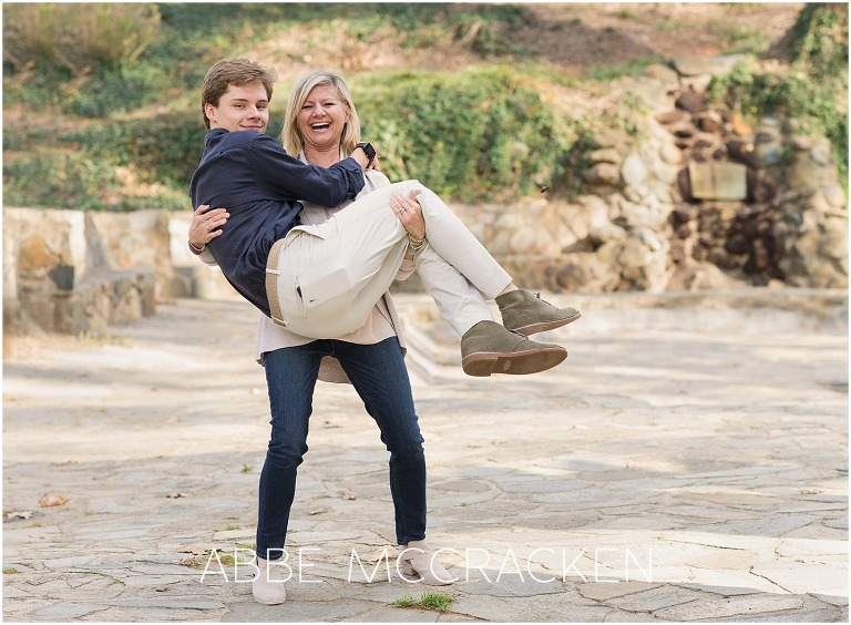 Funny photo of a mom holding her high school senior like a baby