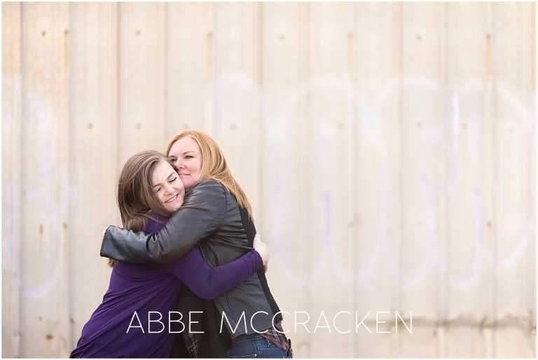 Photo of a mother hugging her high school senior daughter