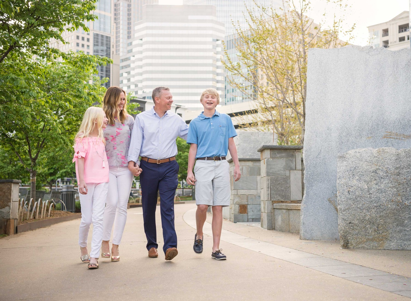 family of four walking in downtown Charlotte, North Carolina
