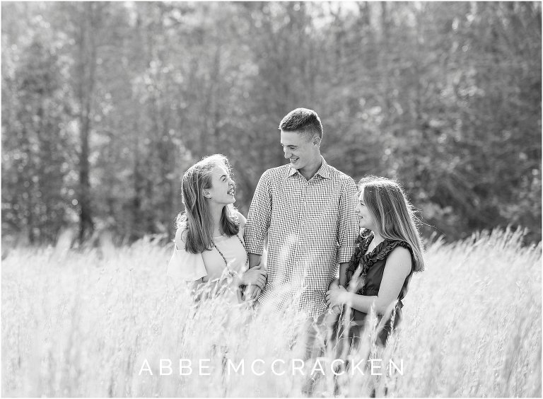black and white candid image of siblings laughing