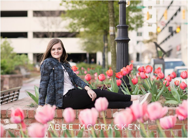Spring senior portrait among the tulips at Romare Bearden Park in Uptown Charlotte