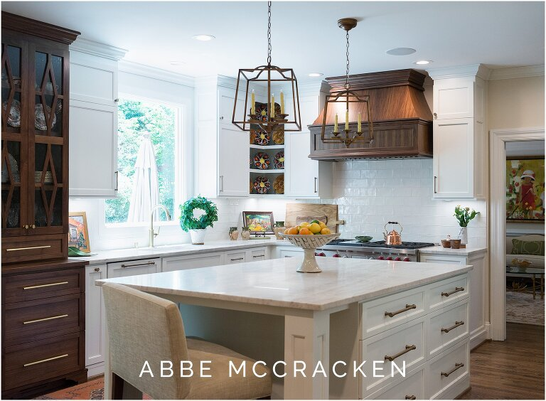 Kitchen renovation with gorgeous white marble and dark woods