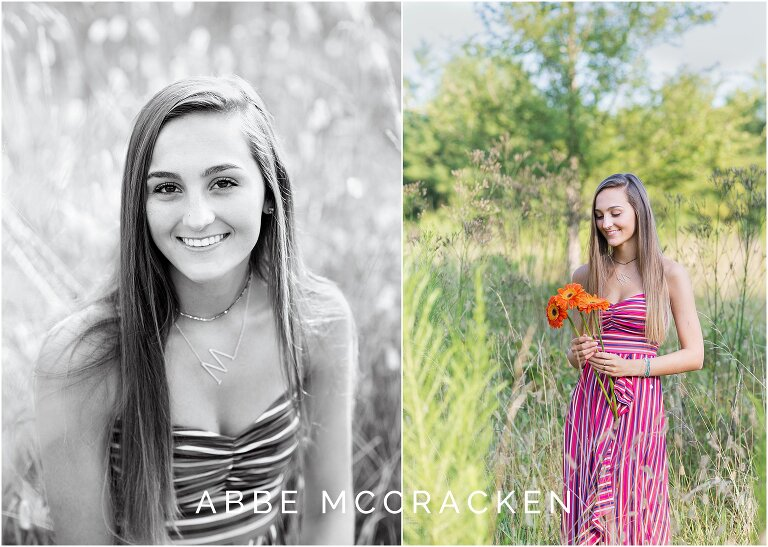 Senior portraits of gorgeous brunette in colorful stripped dress, holding flowers