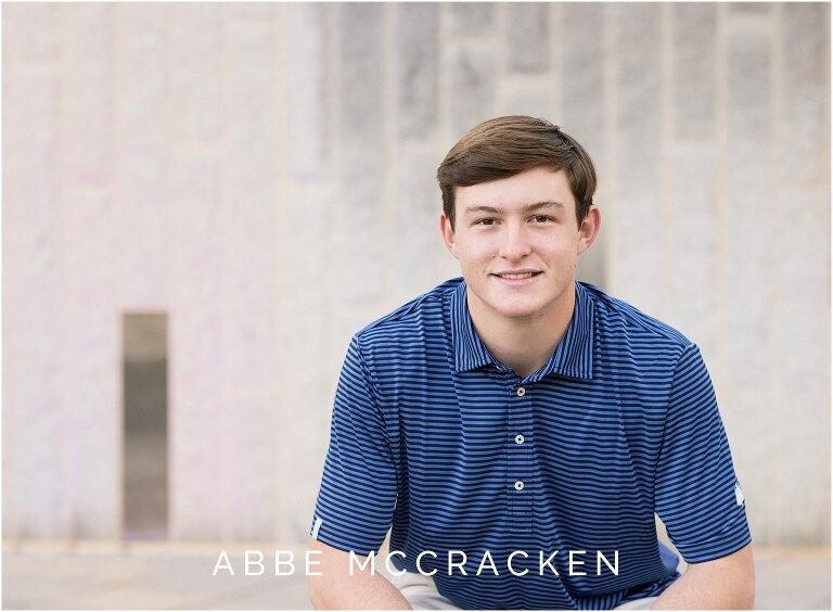 Graduating senior boy in striped blue shirt