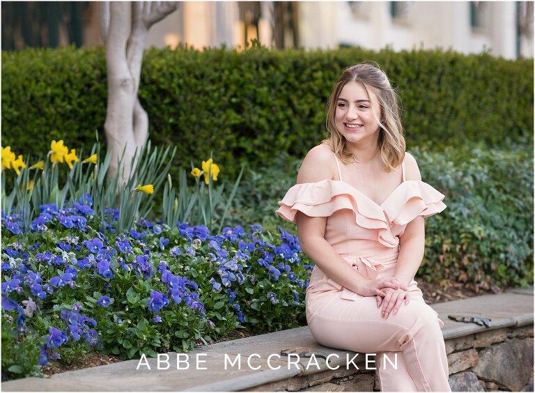 Teenage girl sitting near spring flowers on The Green